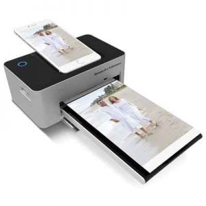 The iPhone Charging Photo Printer - A compact printer with on-board lightning dock that produces vibrant pictures in seconds