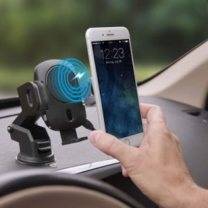 The Robotic Grip Wireless Charging Car Mount - A wireless charging car mount with automatic arms to secure phone